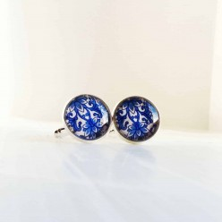 Cuff links with a blue Damask pattern.