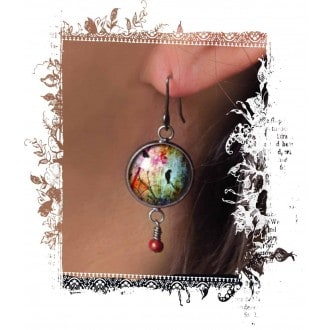 Beaded dangle earrings with birds on the branch theme on a multi-color background