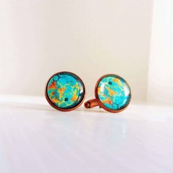 Abstract pattern turquoise and gold cuff links.
