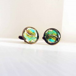Cuff links with khaki and turquoise leaf design.