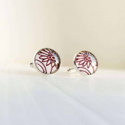 Red and white floral pattern cuff links.