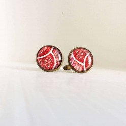 Red feather design cuff links.