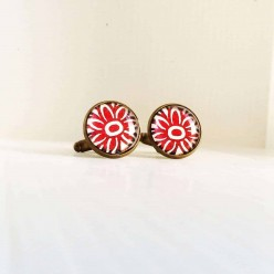 Daisy pattern cuff links in red.