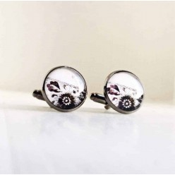 Asymmetrical black and white floral design cuff links.
