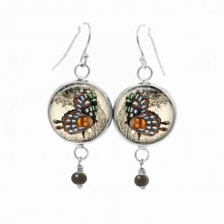 Dangle earrings with an orange and blue butterfly theme