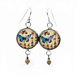 Boucles d'oreilles fantaisie pendantes avec le thème Papillon d'Asie bleu turquoise