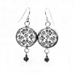 Dangle earrings with black and white floral theme