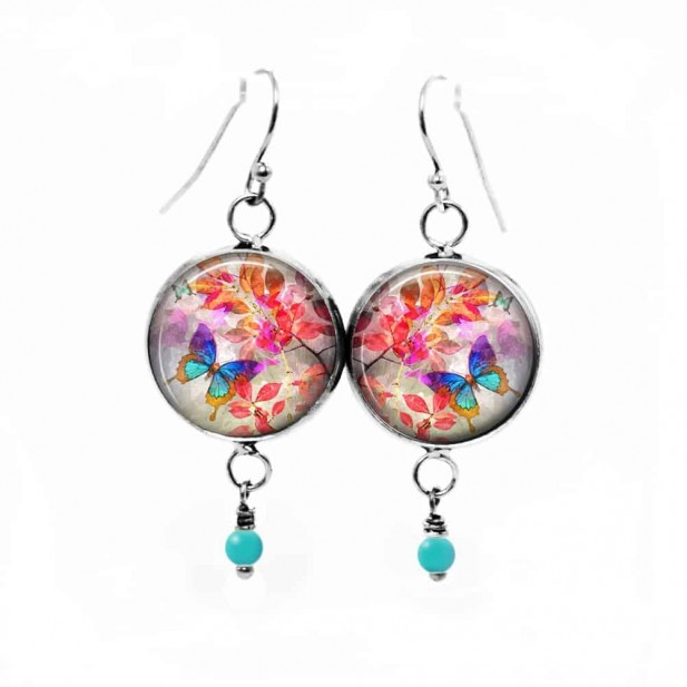Dangle earrings featuring a Summertime theme with a blue butterfly on a red leaf background