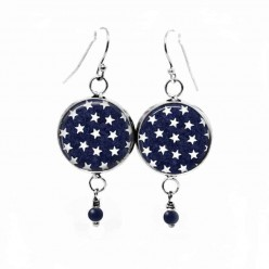 "Dangle earrings with a white stars pattern on a navy ""blue jeans"" background"