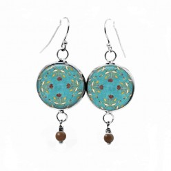 Dangle earrings with a chocolate color floral pattern on an aquamarine background