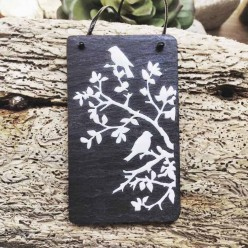 "Slate necklace with a resined white decoupage featuring ""birds in the branches"""