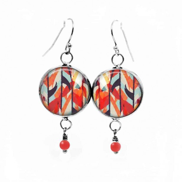 Beaded dangle earrings with a red and navy blue abstract watercolor theme