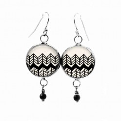 Beaded dangle earrings with a hand-drawn chevron theme in black and cream