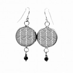 Beaded dangle earrings with a hand-drawn chevron pattern in black and white