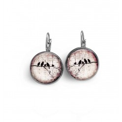 French wire earrings  with a bird family on a branch on a pink background