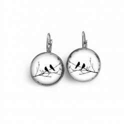 "Lever-back earrings with a black and white ""birds on the branch"" theme."