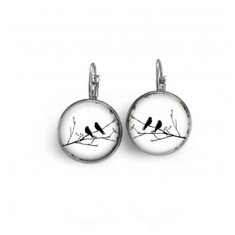 French wire earrings with black and white birds on the branch theme.