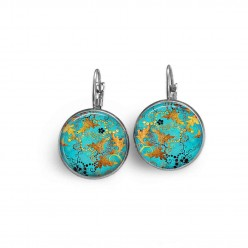 French sleeper style earrings with a turquoise and gold abstract theme.