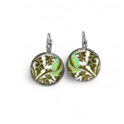 French sleeper style earrings with a green and white floral theme.