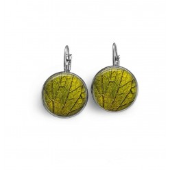 French sleeper style earrings with a green leaf theme.