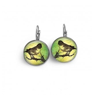 French sleeper style earrings with a stamped bird on an anise colored background.