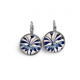 French sleeper style earrings with a blue flower theme.