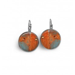 Lever-back earrings with an abstract rust orange and celadon green pattern