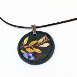 Slate necklace with a floral boho theme on black background - branches and blue flowers