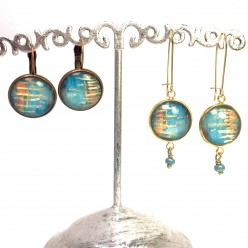 Dangle earrings with an abstract turquoise pattern and gold foil highlights