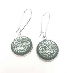 Dangle earrings with foil circles pattern and a forest green watercolor background