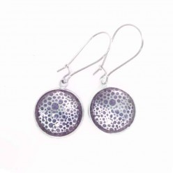 Dangle earrings with circles theme in silver and watercolor purple background