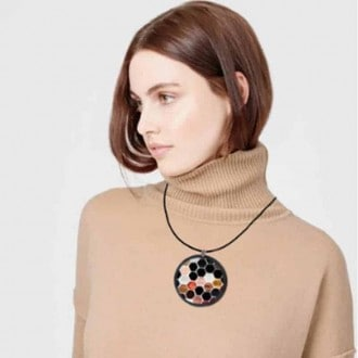 Slate necklace with an earth-tone beehive Hexagons theme