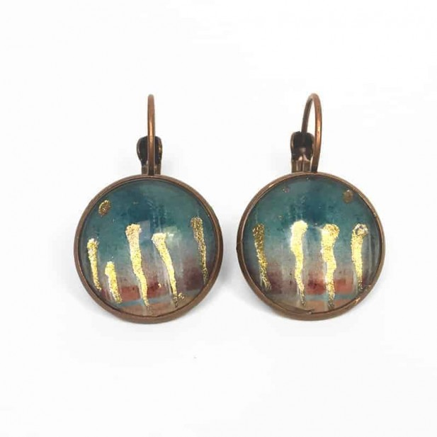 Sleeper earrings with an enchanted forest theme with gold or silver foil highlights