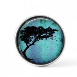 Snap button cabochon for interchangeable jewelry with an acacia tortillis tree theme on a bright turquoise background