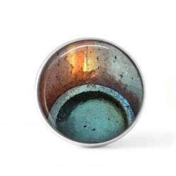 Bouton cabochon clipsable pour bijoux interchangeables avec un motif abstrait rond bleu turquoise et rouille