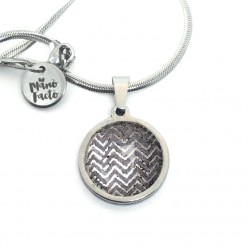 Stainless steel necklace with a silver herringbone theme on a gray background