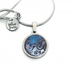 stainless-steel-necklace-with-a-silver-waves-theme-on-a-navy-blue-and-turquoise-background