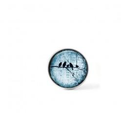 Bouton cabochon clipsable pour bijoux interchangeables : oiseaux sur la branche sur fond bleu