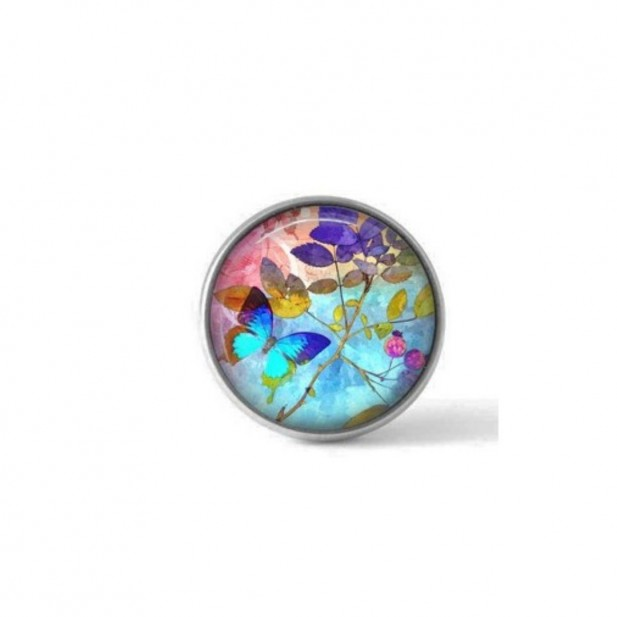 Interchangeable clip on button with a summertime butterfly design in deep turquoise