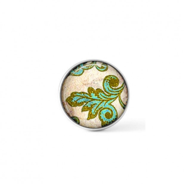 Interchangeable clip-on button with a green baroque leaf theme