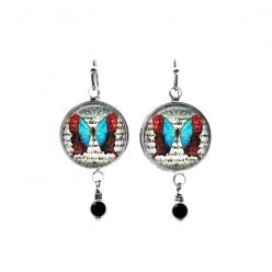 Boucles d'oreilles pendantes avec perles sur le thème du papillon vintage rouge et turquoise