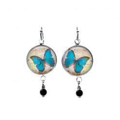 Boucles d'oreilles pendantes papillon turquoise avec perles