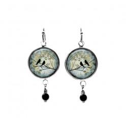 Birds on a branch teal background beaded dangle earrings
