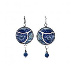 Boucles d'oreilles pendantes bleu marine avec perles sur le thème de la plume abstraite