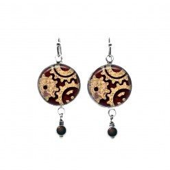 Beaded dangle earrings with a steampunk cogs theme in rust