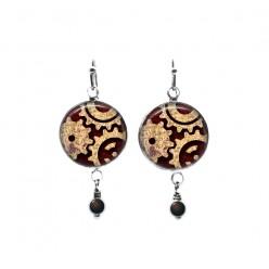 Boucles d'oreilles pendantes avec perles sur le thème des rouages Steampunk en rouille