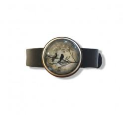 Bracelet en cuir marron avec un fermoir boucle pour boutons interchangeables